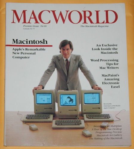 A young Steve Jobs with the first Macintosh.